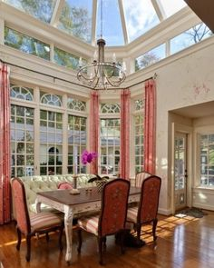 Pink & salmon #color #dining #room and #sunroom #atrium.  Absolutely love the ceiling and banquette.