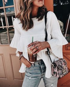 Love this white blouse.