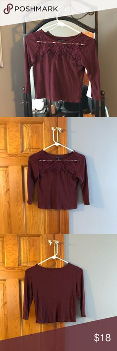 AEO crochet/ribbed burgundy crop top This was only worn once, great condition. Is made from ribbed material & has dainty crochet details on the chest. 3/4 sleeves & cropped! American Eagle Outfitters Tops Crop Tops