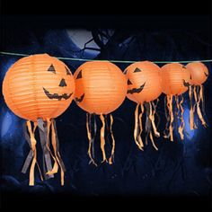 Simple way to decorate your house this Halloween season. Use decorative paper lanterns and add tassels to complete their Halloween look