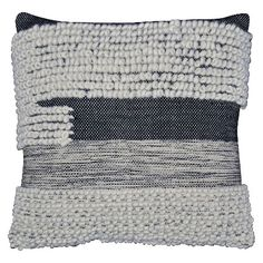 """Laurel & Wolf Designer James Tabb - """"I think [this pillow]works well because it has a more natural texture and pattern but isstill modern and edgy,"""" says Laurel & Wolf Designer James Tabb. """"It would be at home on a large sofa as an anchor to smaller cast members, or as a backdrop to a cozy bed. The color is neutral with high contrast, so itreally makes a visual impact."""""""
