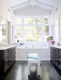 His and Hers Bathroom.  The huge jetted tub in the middle is a great way to create unity between the two seperate areas.