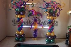 Who knew pairing a little pink and turqoise could look so good with Mardi Gras purple/gold/green????