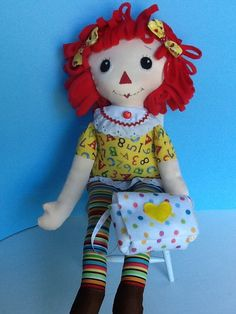 Look! Raggedy Ann is ready to start Kindergarten. This cute, cuddly 22 inch version of Raggedy Ann is sure to delight Raggedy Ann lovers of all ages! This unique pattern combines the doll with unremovable clothes so they never get lost. She has her own backpack is ready for the first day of school!  This Easy Soft 22 inch Cloth Rag Doll PDF Pattern for Raggedy Ann includes pattern for doll with permanent clothes, backpack and hair bow.  **This is a pattern ONLY and not a completed doll…