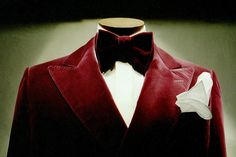 This Red Velvet tux completed with a matching velvet bow tie would be the appointed costume to the Knave of Hearts. With altering the ensemble would be form fitting to the actor chosen. This way his movements would come across as a little stiff but, his facial emotions would be as eager as his subservient personality.