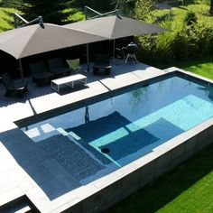 Swimming pool design by Carré Bleu - Small pool with Covered Deck - mostly above ground