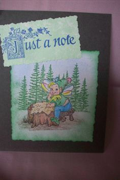 """""""Just a note"""" is from a rubber stamp.  Another stamp made the trees, and one more make the elf at the stump."""