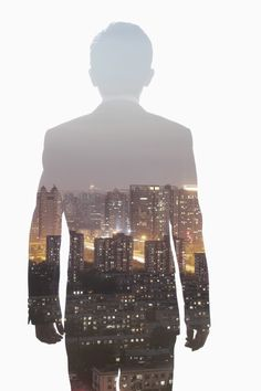 Double exposure of young businessman and the skyline of Shanghai