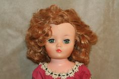 New Dollikin Mickie's beautiful face. Lots of curly red hair and a side part.