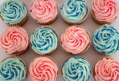 Blue and pink cupcakes-- love the matching sprinkles and how beautifully that frosting swirls!