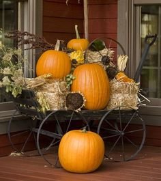 Building on the Past - Great Pumpkins A vintage wagon piled with oversized pumpkins, hay bales, and dried sunflowers announces autumn's arrival on the Harrises' outshot porch. - Country Sampler