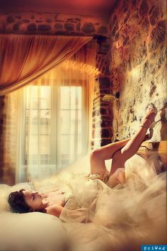 There's a sexy elegance to this photo. The lighting and the room decor really create a wonderful ambiance! Brilliant for capturing the garter. Wedding photo inspiration. Garter photo inspiration
