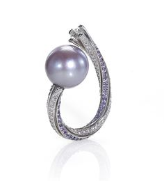 "Darryl Alexander, Alexander's Jewelers, Gilbert, AZ. Palladium ""Purple Passion"" ring featuring a 14mm pink freshwater Pearl accented with purple Sapphires and Diamonds."