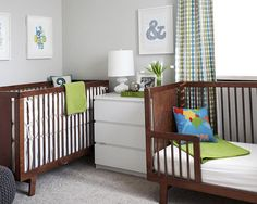 Grey green and cyan nursery with mahogany crib