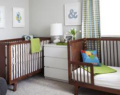 Grey green and cyan nursery with mahogany crib