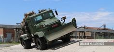 Special chassis KrAZ-7634NE (KrAZ N27.3EH) military with a bucket  Modern Ukrainian military equipment