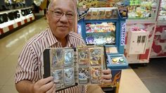 Senior citizens having fun at arcades: Mr George Gan, 68, with his collection of cards from the Animal Kaiser game. http://www.straitstimes.com/news/singapore Photo: Desmond Lim/The Straits Times