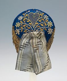 1830-60 German  The charming folkloric pattern on this beautiful cap incorporates the tree of life, a common embroidery motif in many cultures. Its combination with the heart creates a hopeful and life-affirming sensibility