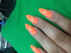Neon orange stiletto nails