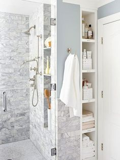 Open shelves provide easy access to needed items and are cleverly tucked into a sliver of space between the shower and a wall. Only inside the shower.