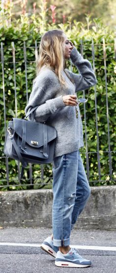 Knitwear Fashion Trend: Virginia Varinelli is wearing a sweater from Prada, Jeans from Gap, shoes from Nike and the bag is from Gigi New York