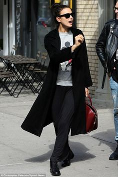 Irina Shayk wearing Celine Tilda Sunglasses, Saint Laurent Master Lace-Up Combat Boot, Givenchy Medium Antigona Bag in Burgundy and Scoop Silk and Cashmere Duster Cardigan in Black
