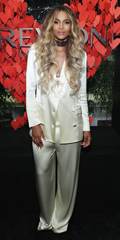 Ciara mastered relaxed suiting at the Revlon x Ciara launch event. She wore ivory satin suit separates by Houghton, styling the set with nothing else but a bra and a black choker.