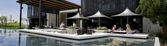 This setting at Steenberg estate surely must be one of the best locations to taste wine: http://www.steenberg-vineyards.co.za/