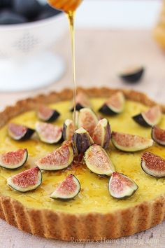 A creamy, sweet ricotta tart brushed with honey and decorated with flagrant fresh figs. Recipe from roxanashomebaking.com
