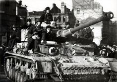"""Bulgarian soldiers on German tank Pz.Kpfw. IV Ausf. H during the parade in Sofia. The inscription """"Nish"""" notes on the tank cars involved in the battle for the Serbian city of Niš in Niš operations in October 1944."""