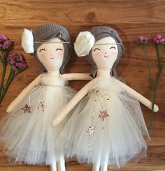 SOPHIE is one of the Twin Sisters. She is wearing a beautiful tutu dress and ready to show here talent! She's available in 21 inches and 17 inches. STORY The Twin Sisters love to travel all over the world and explore different cultures. Their dream is to become a fashion designer. ________________________________________________________ MADE IN NYC Our Twin Sisters Doll Collections are made with natural fabrics and up-cycled cashmere sweater for the hair. Made with the most fine materials, caref White Tutu, Kids Boutique, Twin Girls, Fashion Design, Handmade, Fabric, Creative, Doll Hair, Clothes