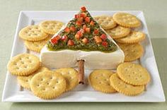 Cream Cheese Pesto Christmas Tree. Serve with veggies. I made one like this using ligth Phili topped with sweet chili sauce and diced coriander.