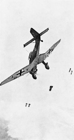 Bombs falling away from a Junkers Ju-87 Stuka dive-bomber. The photograph appears to have been taken from a following aircraft, 1940