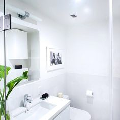 A geometric bathroom in Pure White Caesarstone by the talented designers at Overland Remodeling. Nothing says clean like an all white bathroom. Just add a live plant to give a pop of color- they make the best bathroom decoration