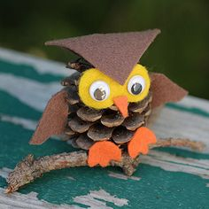 owl crafts for kids to make | How to Make an Owl Out of a Pine Cone you will also need felt and googley eyes