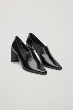 These heels are made from softly-constructed leather with contrast piping along the edges. A pointed style, they have a V-shaped front detail, curved leather-covered heels and reinforcement at the toes and heels for added structure. Cow Leather, Leather Heels, Heeled Loafers, Shoe Collection, Black Shoes, Pumps, Cos, Image, Pillows