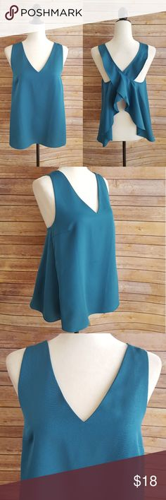 """NWT Ro & De Teal Ruffle Open Cross Back Top New w/ tags! Loose fit 32"""" Bust, 25"""" Length (Approx Measurements) 100% Polyester  No trades accepted Open to reasonable offers Save 15% on bundles of 3+ Follow us @mirror.image.trends Ro & De Tops"""