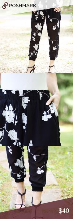 Black + White Floral Pants ▫️️️Chic black+white pants with a silky look and feel. Sewn on floral design. Unique and stylish, reminds me of an expensive designer piece. Built in lining shorts. Adjustable stretch drawstring waist.    ▫️Sizes available: S | M | L ▫️Material: Poly/cotton ▫️I am modeling size S ▫️Price firm unless bundling  Photos are my own. You can always feel safe shopping with me Boutique Pants