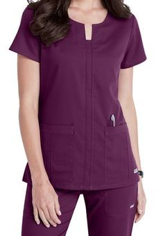 The 3-pocket notched neck scrub top (In Romance) will make a wonderful addition to your lineup! This delightful top separates itself from the pack with features such as a fashion inset detail panel on the front, detail paneling on the back, and a fitted and styled back. Plenty of pocket room is available with two large front pockets plus a fashion inset pocket and inside PDA pocket.