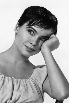 """Leslie Caron, 1955 - This dancer came to Hollywood from France with her talent, dreams & the idea for her look in her 1st movie, """"An American in Paris."""" She asked the set stylist for a short hairdo she saw on a model back home but the stylist refused. She cut it herself, apparently not to the liking of the studio, which delayed filming for a few weeks. Little did they know her gamine beauty would make movie magic, prompting her to go even shorter with jagged bangs for later productions."""