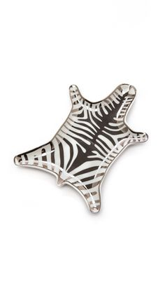 Jonathan Adler Metallic Zebra Dish, Silver: This ceramic Jonathan Adler dish is made in the shape of a zebra-skin rug. Painted silver-tone stripes complete the aesthetic.