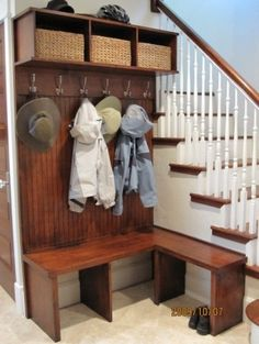 Foyer/entryway. Hooks for hanging, baskets to corral hats, gloves, scarves, and a bench seat with storage underneath for boots/shoes