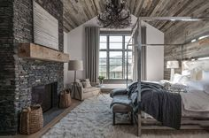 Ski-in/ski-out chalet in Montana with rustic-modern styling- bedroom chandelier