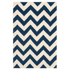 Navy Hand-tufted chevron wool rug.  Product: RugConstruction Material: WoolColor: Dark blue and ivory... $31.95