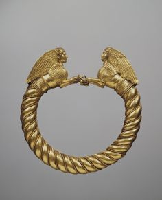 (Bosporan Kingdom) Crimea Gold Bracelet with the Protomes of Shinxes. ca 400-350 BCE. Place of finding is Kul Oba Barrow. Crimea, environs of Kerch, Bosporan Kingdom, Russia. Stamped, decorated with filigree & granulation.