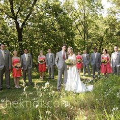 Coral bridesmaid dresses and gray suits paired with yellow ties perfectly embodied casual summer elegance.