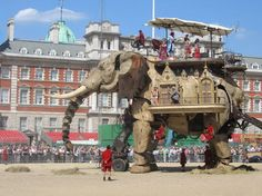 The Sultan's Elephant was a show created by the Royal de Luxe theatre company starring a giant mechanical elephant, a giant marionette doll and a giant rocket ship which was funded by the the French Ministry of Culture and Communication to commemorate the 100th anniversary of the death of Jules Verne. The show was performed around the world between 2005 -2006. via wikipedia http://tinyurl.com/oxkzs  photo by Phil Hunt #Theater #The_Sultans_Elephant #Phil_Hunt