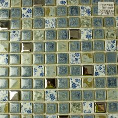 Collection: Porcelain Mosaic Tiles; Material: Porcelain; Shape: Square; Color: Silver and Blue; Size: 300 x 300 x 4 mm; Chip Size: 25 x 25 mmMosaic Tiles specializes in quality handcrafted porcelain mosaic tiles that add excitement to your pool, home, and outdoor area. They are composed of colored porcelain tiles of different shapes and sizes arranged to form lifelike images.Each sheet of the porcelain mosaic tile is approximately 1 sq ft per sheet and is mesh mounted for easy installation… Marble Mosaic, Glass Mosaic Tiles, Stone Mosaic, Mosaic Art, Glass Tile Backsplash, Kitchen Backsplash, Blue Glass Tile, Mosaic Tile Designs, Tile Flooring