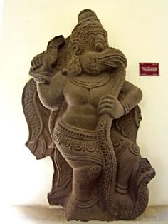 13th century sculpture in the Thap Mam style, depicting Garuda devouring a serpent