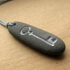 I'm giving away this necklace on my blog! It's a beach pebble that I've hand engraved and strung with a pebble toggle.